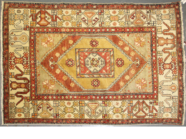 A Turkish rug size approximately 5ft. 5in. x 8ft. 2in.