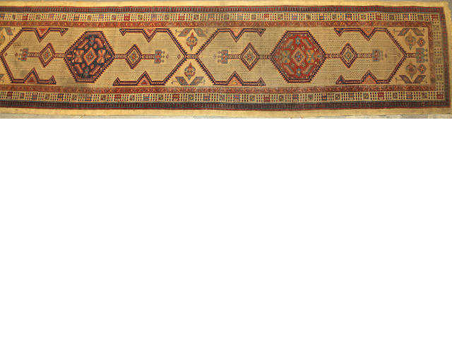 A Serab runner size approximately 3ft. 2in. x 18ft. 3in.