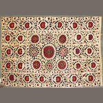 A Suzani textile size approximately 5ft. 6in. x 8ft. 5in.