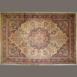 A Tabriz carpet  size approximately 6ft. 9in. x 10ft. 4in.