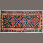 A Louri rug size approximately 3ft. 6in. x 6ft. 8in.