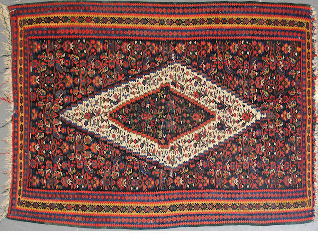 A Senneh Kilim size approximately 3ft. 10in. x 5ft. 1in.