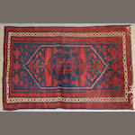 A Belouch rug size approximately 3ft. 7in. X 6ft. 4in.