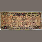 A Turkish kilim size approximately 5ft. 5in. X 12ft. 9in.