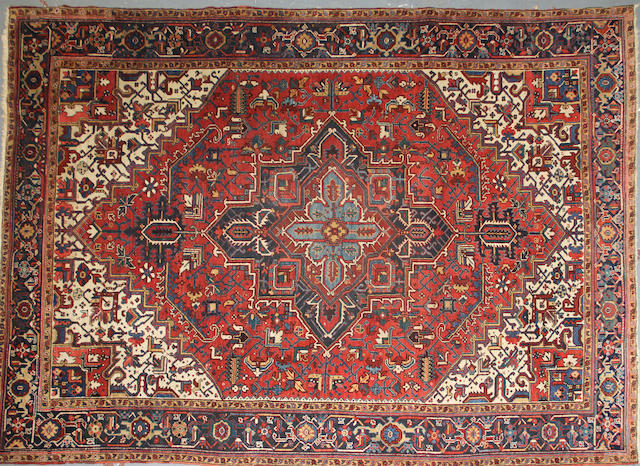 A Heriz carpet size approximately 8ft. 6in. x 11ft. 6in.