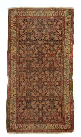 An Agra rug size approximately 3ft. 2in. x 5ft. 8in.
