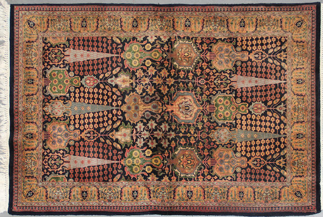 An Indian rug size approximately 3ft. 8in. x 4ft. 8in.