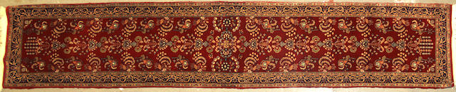 An Indian runner size approximately 2ft. 6in. x 13ft. 7in.