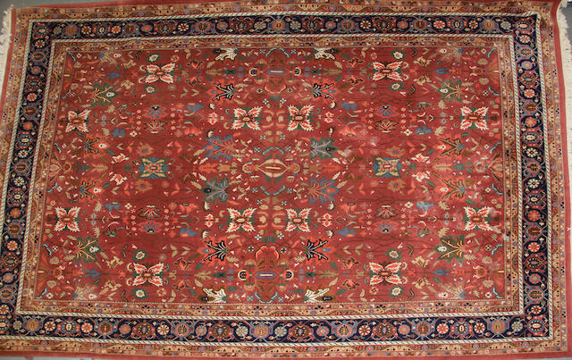 An Indian carpet size approximately 10ft. x 16ft. 4in.