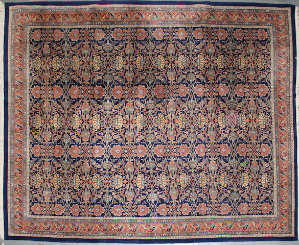 An Indian carpet size approximately 8ft. 10in. x 11ft. 4in.