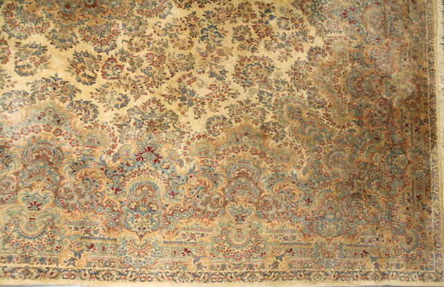 A Kerman carpet size approximately 15ft. x 18ft.