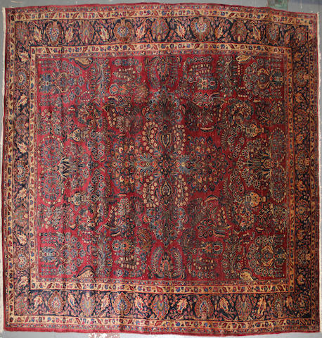 A Sarouk carpet size approximately 8ft. 8in. x 11ft. 6in.