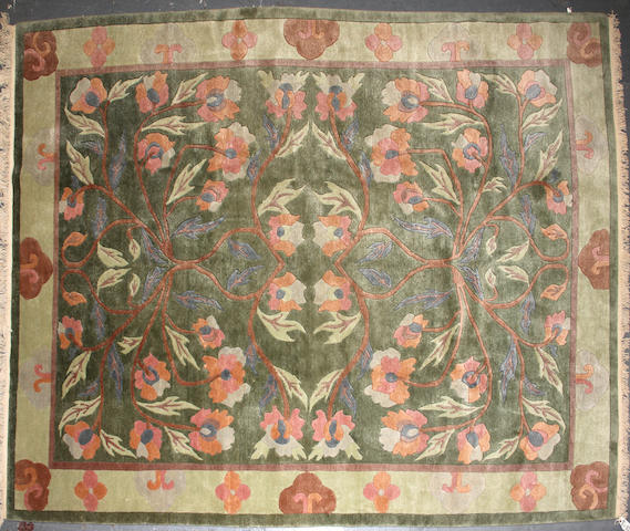 A Napalese carpet size approximately 8ft. 1in. x 11ft. 8in. size approximately 8ft. 1in. x 11ft. 8in.