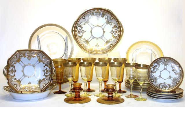 An assembled grouping of gilt rimmed stemware and Noritake porcelain