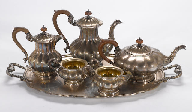 A Canadian sterling five piece tea and coffee set with tray Henry Birks & Sons, Montreal, dated 1947 and 1949  #s 59/2,  59/3, 59/4E, 59/5E, 59/7 (set) and 54/9A (tray)