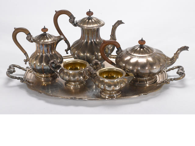 A Canadian sterling five piece tea and coffee set with tray Henry Birks & Sons, Montreal, dated 1947 and 1949 <BR />#s 59/2,  59/3, 59/4E, 59/5E, 59/7 (set) and 54/9A (tray)
