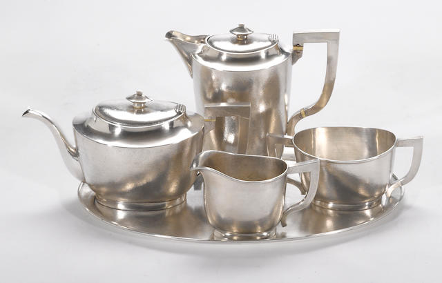 A Chinese export silver four piece tea set with matching tray Luen Hing, Shanghai, circa 1910  (5)