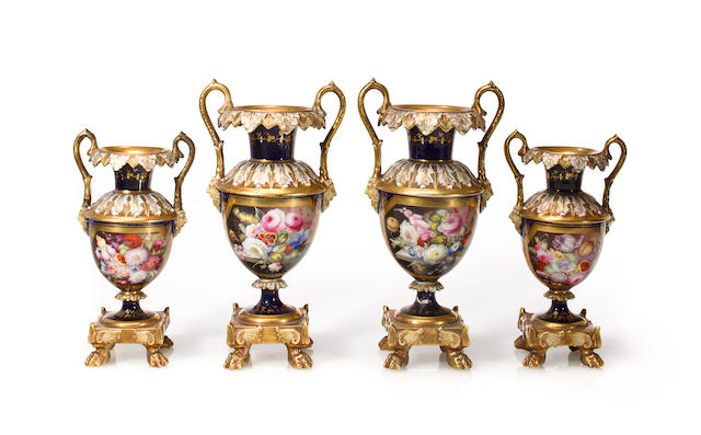 Two graduated pairs of Worcester porcelain floral decorated two handled vases <BR />mid- 19th century