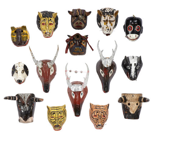 A collection of fifteen Guatemalan masks