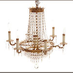An Empire style gilt metal and glass chandelier