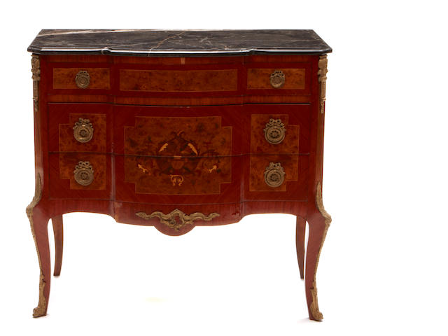 A Louis XV/XVI Transitional style gilt bronze mounted marquetry inlaid walnut commode with marble top