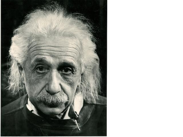 [EINSTEIN, ALBERT. 1879-1955.] Gelatin silver print portait photograph by PHILIPPE HALSMANN, 9 1/4 by 7 inches, few creases and a small stain on left edge.