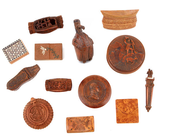 An assembled group of thirteen carved wood decorative boxes