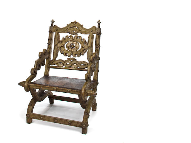 An African brass and wood armchair