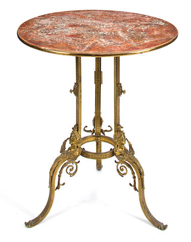 A Neoclassical style gilt bronze and faux marble center table