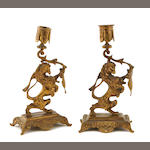 A pair of Tiffany and Co. gilt bronze figural candlesticks