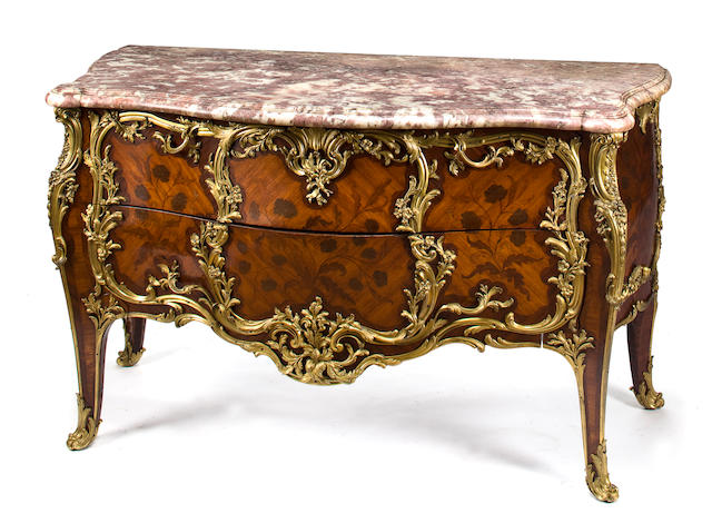A superb Louis XV style gilt bronze mounted kingwood marquetry commode with pink-beige marble top<BR />in the manner of BVRB (Bernard van Risenburgh (born after 1696 - circa 1766)<BR />attributed to Paul-Charles Sormani (1848 - after 1909)<BR />fourth quarter 19th century