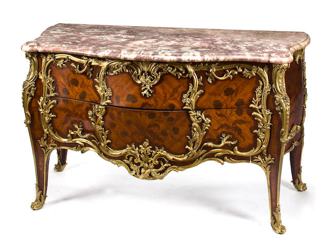 A superb Louis XV style gilt bronze mounted kingwood marquetry commode with pink-beige marble top after a model by Joseph Baumhauer, known as Joseph (d. 1762) attributed to the Maison Jansen late 19th century
