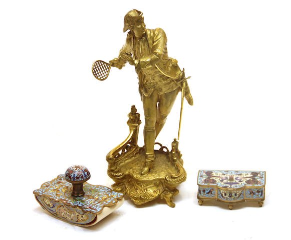 A French gilt metal figure of a badminton player and two gilt bronze and champlevé enamel desk accessories late 19th/early 20th century