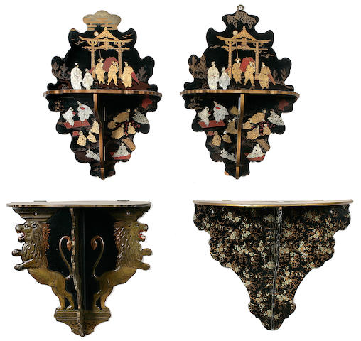 A group of four folding lacquered wall brackets<BR />20th century