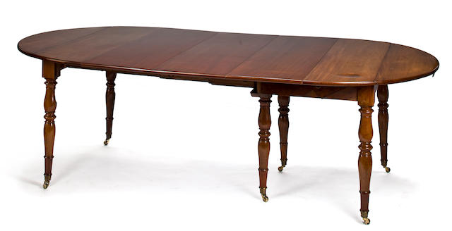 A Louis Philippe walnut extension dining table