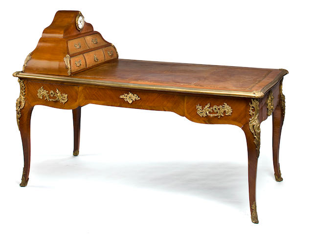A Louis XV style gilt bronze mounted mahogany partners' bureau plat with associated cartonnier<BR />late 19th/early 20th century