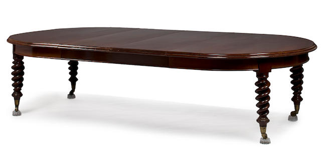 An Italian carved mahogany extension dining table<BR />third quarter 19th century