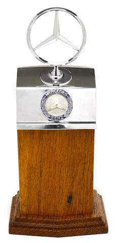 A Mercedes-Benz radiator badge desk piece,