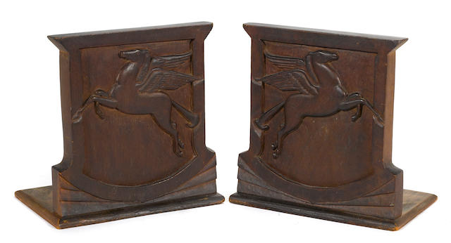 A fine carved set of Mobil Pegusus book ends, c50s,