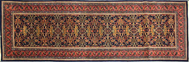 An Indian carpet0.00 size approximately 2ft. 6in. x 8ft.