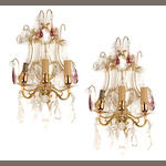 A pair of gilt brass clear and colored glass three light bras de lumière