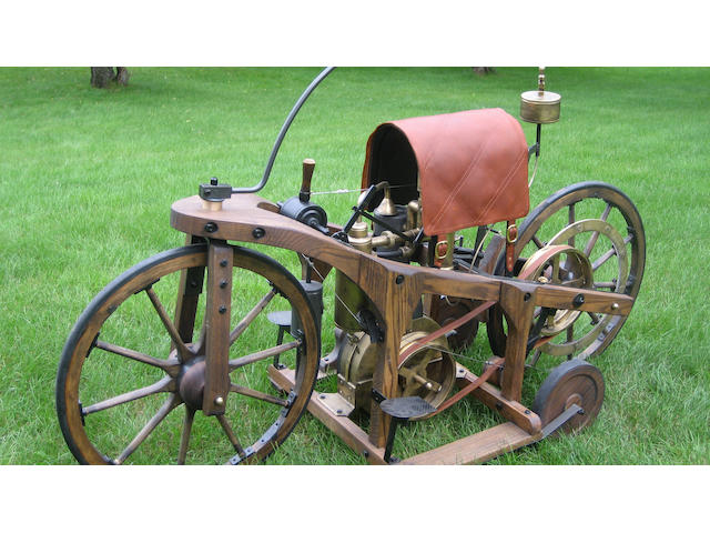 A fine full size replica of an 1885 Daimler Reitwagen,