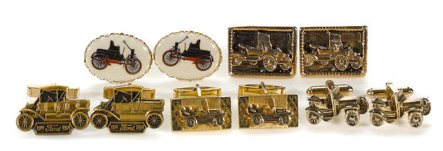 A collection of five sets of motoring cuff links,