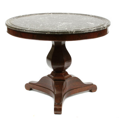 A Regency style mahogany and marble center table