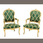 A pair of Italian Rococo style parcel gilt paint decorated armchairs