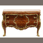 A Louis XV style gilt metal mounted inlaid commode