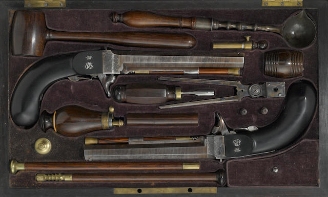 A cased pair of French percussion underhammer pistols made for a member of the nobility