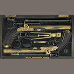 A fine cased pair of gold encrusted French percussion pistols by Devisme
