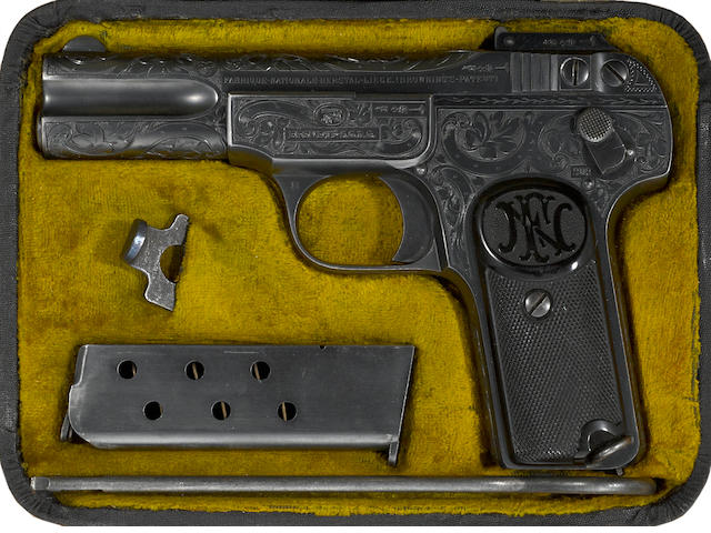 A scarce cased and factory engraved FN Model 1900 semi-automatic pistol
