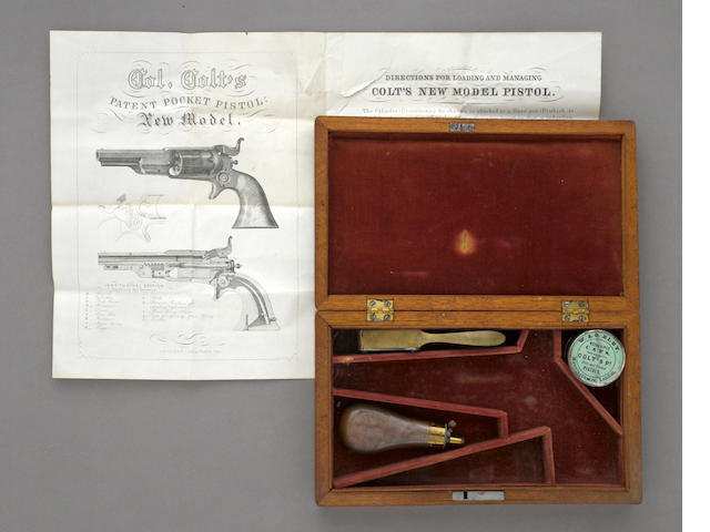 A case and accessories for the Colt Model 1855 Root percussion revolver